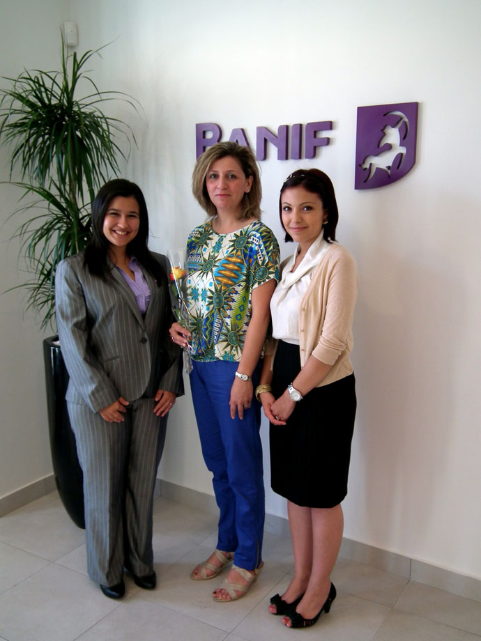 Banif staff presenting rose to client